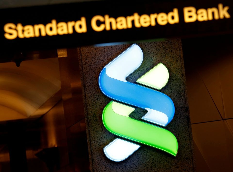 StanChart to cut branch network in half, quarterly profit beats expectations
